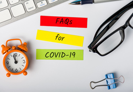 COVID-19 FAQs in Goodlettsville on colorful paper on desk