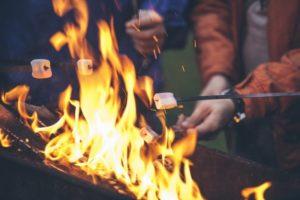 family roasting marshmallows over firepit from dentist in Goodlettsville